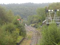 A wealth of home signals covering the loop section of the Margam line beyond Tondu station junction as seen from the station footbridge in September 2011. The former Margam bound platform face can still be seen on the left. This line has seen extensive week-end freight use over winter 2011-12 to allow steel services to bypass track works taking place between Margam and Bridgend <br><br>[David Pesterfield&nbsp;14/09/2011]