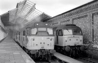 31276 and 47196 amongst locomotives stabled at Workington on 19 February 1992.<br> <br><br>[Bill Roberton&nbsp;19/02/1992]
