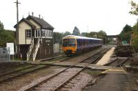 A First Great Western service to Paddington departs south from Moreton-in-Marsh on 21 September 2011. Evidence of the rationalisation of the trackwork is evident with the remnants of the down sidings on the right of the photo.<br> <br><br>[John McIntyre&nbsp;21/09/2011]