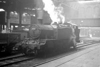 Collett 2-6-2T no 8109 potters around in the shadows at Birmingham Snow Hill on 22 October 1964, some 8 months before withdrawal from nearby Tyseley shed. On the adjacent line Churchward 2-8-0 3808 is passing through the station with an up goods train [see image 34443].<br><br>[K A Gray&nbsp;22/10/1964]
