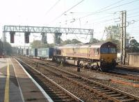 Substitute on the <I>Tesco Express</I>. Running around one hour late through Preston with the 4S43 Rugby to Mossend on 280911, DBS 66134 was presumably covering for a defective Class 92 electric. <br><br>[Mark Bartlett&nbsp;28/09/2011]