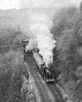 On its first outing after restoration from Barry scrapyard condition, preserved ex S&DJR 2-8-0 No. 13809 passes New Mills Central station with the <I>Pines Express</I> excursion of 2nd May 1981. The train, which had originated in Leicester, was powered by 13809 from Guide Bridge to York and then back to Sheffield. Just in front of  the locomotive is the turnout for the Hayfield branch, the stub of which was retained as a turnback siding for terminating local trains from Manchester Piccadilly.<br><br>[Bill Jamieson&nbsp;02/05/1981]
