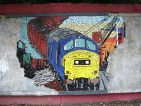 A tile mural section, depicting a past era of class 37s on coal trains in the Welsh Valleys, still relatively complete along the back wall of the Cardiff bound platform at Trehafod Station on the Treherbert branch in September 2011. <br><br>[David Pesterfield&nbsp;14/09/2011]