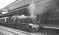 Ex-GWR Hall class 4-6-0 no 4993 <I>Dalton Hall</I> waits with a train at Exeter St Davids in August 1961.<br><br>[K A Gray&nbsp;17/08/1961]