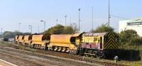 EWS liveried 08737 is the yard shunter at Westbury on 29 September 2011.<br><br>[Peter Todd&nbsp;29/09/2011]