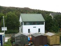 What looks like the former Plockton signal box, is in fact a bunkhouse. Seen here on 22 September looking south across the line from Station Road.<br><br>[Alistair MacKenzie&nbsp;22/09/2011]
