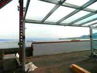 Looking out over the Clyde from Gourock station on 30 September showing a section of the new glazed canopies currently under construction.<br><br>[John Yellowlees&nbsp;30/09/2011]