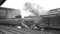Stanier Coronation Pacific no 46251 <I>City of Nottingham</I> stands at Carlisle on 25 April 1964 with the 10.5am Glasgow Central - Birmingham New Street.<br><br>[K A Gray&nbsp;25/04/1964]