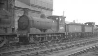 Class J36 0-6-0 no 65275 stands alongside the water tank at 66B Motherwell shed, thought to have been taken in late 1963.<br><br>[K A Gray&nbsp;//1963]
