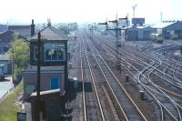 View west at Haymarket Central Junction in the spring of 1971, as seen from the bridge carrying the closed CR Granton branch over the NB main line. The 'Sub' curves off sharply to the left not far beyond the signal box. Locomotives of classes 25, 27 and 40 can be seen on Haymarket shed.<br><br>[Bill Jamieson&nbsp;//1971]