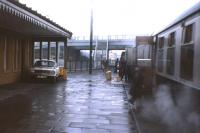 When Muir of Ord station re-opened in 1976, having been closed for 16 years, it had a station building, a parcels service �and steam heating, as shown in this early 1977 shot. Nowadays it has a bus shelter of course! [See image 5856]<br><br>[Frank Spaven Collection (Courtesy David Spaven)&nbsp;//1977]