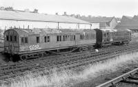 Adjacent to Leith Walk East and the line to Granton, these two former departmental coaches were awaiting disposal on 8 February 1978. Furthest away is a Gresley suburban, while the closer vehicle carried the legend: BR TOOL & MESSING VAN - CHIEF ENGINEERS DEPARTMENT - SAWMILL SIDINGS - LEITH WALK - EDINBURGH - KDM 395890<br> <br><br>[Bill Roberton&nbsp;08/02/1978]