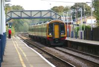 A South West Trains Waterloo to Exeter 6 car DMU with 159011 leading and 159014 at the rear flies westward through Overton station west of Basingstoke just after midday on 23 September 2011.<br> <br><br>[John McIntyre&nbsp;23/09/2011]