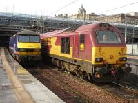 Come in number 19. No not you, that wayward one on the right. 67019 with wheel chocks in place stands alongside ScotRail liveried 90019 in Edinburgh Waverley's east end loco stabling bay. It was later noted stabled on Craigentinny Depot in the early evening. <br><br>[David Pesterfield&nbsp;04/10/2011]