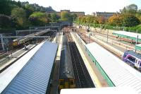 A September view west from Waverley Bridge, with an arrival from Milngavie on the left and departures for Dunblane and Glasgow Queen Street waiting at the platforms. In Princes Street Gardens the autumn colours have begun to appear.<br><br>[John Furnevel&nbsp;27/09/2011]