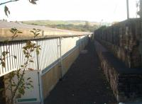 The small terminus at Bacup was quickly demolished after closure on 5 December 1966 and replaced with a factory building. 45 years later this is the view along the trackbed from the buffers with only the retaining wall remaining to identify the location. [See image 33963].<br><br>[Mark Bartlett&nbsp;29/09/2011]