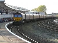 DBS 66120 leaves Kilmarnock long lyes on 7 October with 4S62 Milford to New Cumnock empty hoppers.<br><br>[Ken Browne&nbsp;10/10/2011]