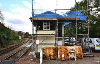 Restoration work is ongoing at Glennfinnan Station, including the signal box. Although the box is no longer used in conjunction with regular train movements, its levers and frames are intact. The upper level is to be fitted out as an audio-visual centre.<br> <br><br>[John Gray&nbsp;10/10/2011]