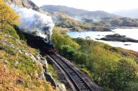 Leaving a smoke trail round the edge of Loch nan Uahm, Black 5 No.44871 builds up some speed on 11 October as it approaches the first tunnel on the 1 in 48 gradient of Beasdale Bank with <i> The Jacobite </i>.<br> <br><br>[John Gray 11/10/2011]