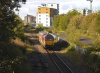 DBS 67011 returns light from Powderhall to Millerhill at the former  Lochend Junction on 11 October 2011. Here lines diverged left to Abbeyhill and right to Leith Central.<br><br>[Bill Roberton&nbsp;11/10/2011]