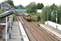 The west end of Falkirk Grahamston station on 25 July 2011, with the 14.28 Dunblane - Edinburgh Waverley service slowing on its approach to platform 1.<br><br>[John Furnevel&nbsp;25/07/2011]
