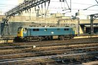 86247 sets off for Willesden depot, having been released from the train that it has earlier brought into Euston in March 1976. With the advent first of DVT working and now the muliple unit, this activity is seldom necessary these days.<br> <br><br>[John McIntyre&nbsp;20/03/1976]