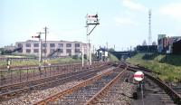 View east at Lochend Junction in the late spring of 1971, with one of the floodlights of Meadowbank Stadium in the right background. The spur from London Road Junction is on the immediate left of the camera and beyond that the tracks to Easter Road Junction are seen dipping down to pass under the London Road Junction to Leith Central line. Furthest left is the spur to Lochend North Junction and Leith Central.<br><br>[Bill Jamieson&nbsp;//1971]