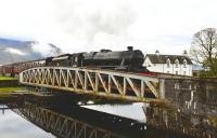 Black 5 no 44871 eases slowly across the swing bridge at Banavie with <I>The Jacobite</I> on 13 October 2011.<br> <br><br>[John Gray&nbsp;13/10/2011]