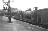 Ex-Caledonian 3F 0-6-0 no 57689 southbound on the main line through Motherwell in May 1963 with a brake van.<br><br>[Colin Miller&nbsp;/05/1963]