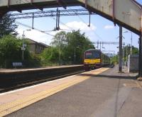 ScotRail EMU 320051 slows for the stop at Westerton on 3 June 2011<br><br>[Ken Browne&nbsp;03/06/2011]