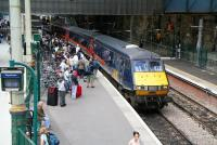 A late running morning GNER Glasgow Central - London Kings Cross service slowly draws to a halt at a crowded Edinburgh Waverley platform 2 on 5 July 2007.<br><br>[John Furnevel&nbsp;05/07/2007]