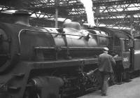 BR Standard Class 4 2-6-0 no 76050 prepares to leave Waverley platform 8 circa 1964. The train is thought to be the 4.10pm to Hawick - extended to Riccarton Junction on Saturdays.<br><br>[David Spaven&nbsp;//1964]