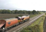EWS 66200 eastbound from Woodborough on 12 October with a stone train. <br> <br><br>[Peter Todd&nbsp;12/10/2011]
