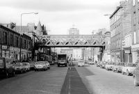 Looking north along Leith Walk towards the Forth in September 1978. The view is dominated by the bridge built to carry the Caledonian Railway's 'Leith New Lines' across the Walk en route to the eastern docks. <br><br>[Bill Roberton&nbsp;/09/1978]