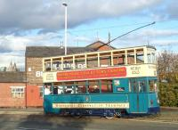 Tram no 69 from Wirral Transport Museum stands at Birkenhead Woodside on 16 October 2011. The tramway operates two Hong Kong trams built in 1992. These are numbered 69 and 70 to follow on from the original Birkenhead Corporation Trams whose numbers went up to no 68. Note part of the Royal Liver Building visible across the Mersey in the left background. [See image 34706] <br><br>[Bruce McCartney&nbsp;16/10/2011]