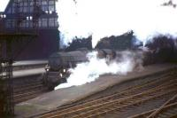 A pair of Black 5s pulling out of Edinburgh's Princes Street station on 24 October 1964 with the 10.10am departure for Birmingham New Street.<br><br>[Frank Spaven Collection (Courtesy David Spaven)&nbsp;24/10/1964]