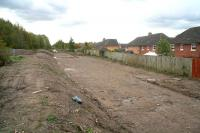 Preparations at the site of the future Newtongrange station, looking south towards Gorebridge on 19 October 2011. The gardens of Jenks Loan, one of a number of modern developments in the area, run alongside the formation on the right, with the A7 behind the camera. The original Newtongrange station stood on the other (north) side of the A7 road bridge. [See image 24342] <br> <br><br>[John Furnevel&nbsp;19/10/2011]