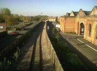A section of the original 1838 London and Birmingham Railway, looking north through Wolverton works. It was later bypassed by the 1881 LNWR route and is now ignominiously sandwiched between an approach road to Tesco and industrial units housed in former Works buildings. The Railcare facility now served by the line is off to the left.<br><br>[Ken Strachan&nbsp;14/10/2011]