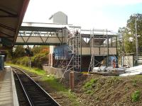 Footbridge/access improvements in progress at Wrexham General station on 12 October 2011, view south along platform 3 with a platform 4 waiting shelter visible to right of the new steps structure [see image 35162].<br><br>[David Pesterfield&nbsp;12/10/2011]