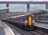 First ScotRail 156446 waits at Carlisle platform 7 with a service to Dumfries on a dismal Saturday afternoon in September 2011.<br><br>[Andrew Wilson&nbsp;03/09/2011]