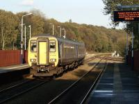A service for Manchester Victoria departs from Lostock station and is about to cross Lostock Junction on 22 October 2011. The train has come from Blackpool North and travelled from Preston via Chorley. The line joining from the right is from Wigan and Westhoughton. <br> <br><br>[John McIntyre&nbsp;22/10/2011]