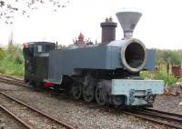 Scene at Becconsall on the West Lancashire Light Railway on 23 October 2011, where Kerr Stuart 0-6-0 WT+T <I>Joffre</I>, with boiler in place and tanks filled with water, was being checked for problems before the next stage of restoration. The photograph shows the locomotive being propelled back into the shed road by a Planet 4w DM shunter following the first test run. [See image 23187] <br> <br><br>[John McIntyre&nbsp;23/10/2011]