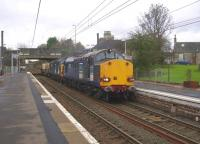 DRS class 37s nos 37607 and 37038 slowing for a signal stop at Kilwinning on 26 October with the 6M22 Hunterston - Carlisle nuclear flask train.<br><br>[Ken Browne&nbsp;26/10/2011]