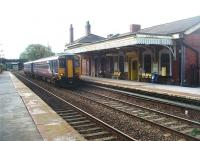 Drawing up alongside the original, and still staffed, station building at Prescot on 13 October is 156472 on a stopping service from Liverpool to Wigan. This view looks towards Huyton and will change soon as the electrification of the line proceeds. <br><br>[Mark Bartlett&nbsp;13/10/2011]