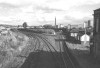 The east end of the old Alloa station, seen here in 1975, approximately 7 years after closure to passengers. The Devon Valley route, closed completely in 1973, runs off to the left and Alloa East signal box is now boarded up. On the other side of the old Waggonway Bridge stands the now demolished brewery, the site of which is today occupied by the new (2008) Alloa station and the Asda Superstore. [See image 18651] <br><br>[Bill Roberton&nbsp;//1975]