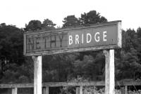 The station nameboard at Nethy Bridge in June 1974. The British Railways two part enamel sign was placed over the earlier sign after the raised letters were removed. Unfortunately, by the time the photograph was taken, part of the enamel sign had also been removed, leaving this strange combination.<br><br>[John McIntyre&nbsp;15/06/1974]