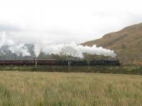 The southbound <I>Jacobite</I> stock working from Fort William to Carnforth pounds away from Arrochar and Tarbet behind two <I>Black 5s</I>. 45407 was leading 44871 and in tow were 9 coaches and a Class 37 diesel. [Photo by Sue Chattwood.]   <br><br>[Malcolm Chattwood&nbsp;31/10/2011]