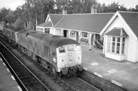A pair of class 24s heading south through Carrbridge station in 1973. The signal box was located in the far bay window.<br><br>[Bill Roberton //1973]