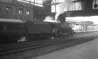 Black 5 no 45148 at Carlisle on 22 February 1964 with the 9.25am Crewe-Perth. <br><br>[K A Gray&nbsp;22/02/1964]