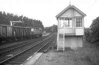 Summer 1969 at Lairg, with a Class 26 about to head south with the return working of the daily Inverness-Lairg freight. At the peak of rail activity after the discovery of North Sea oil and the opening of the Invergordon aluminium smelter, there were five daily freight trains on the Far North Line - one through to Wick and Thurso, one to Lairg and three to Invergordon. <br><br>[David Spaven&nbsp;//1969]
